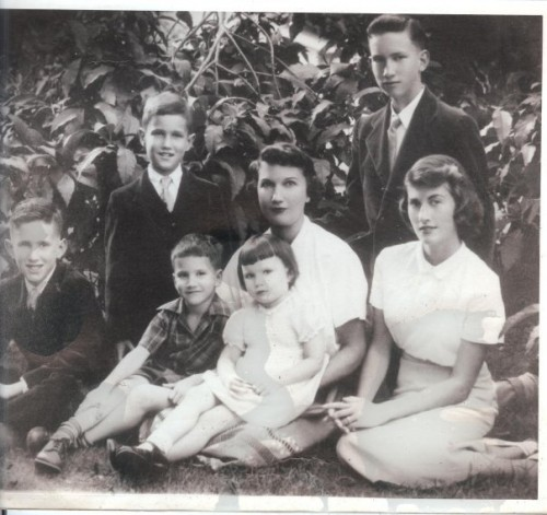 MY MOMS FAMILY...my mom is on the bottom far right...her Mother center holding her baby sister, Susie. and her brother Dick is right behind her. brother Dick