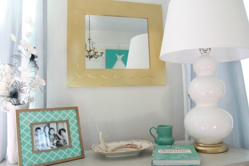 I got this mirror at a used furniture store, it was originally pink. I painted it with my trust gold spray paint and love the way it pops against the soothing gray walls.