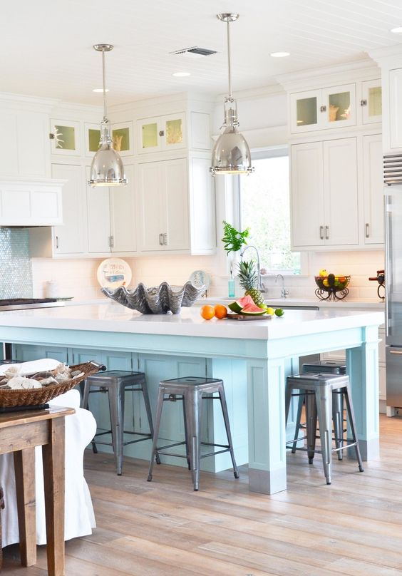 PURE JOY HOME - I LOVE THE GIANT CLAM SHELL WHICH SERVES AS A CENTER PIECE OF THE ISLAND!!! ALSO UNDER CABINET LIGHTING CAN SERVE TO BRING THE LIGHT DOWN AND WARM UP A ROOM