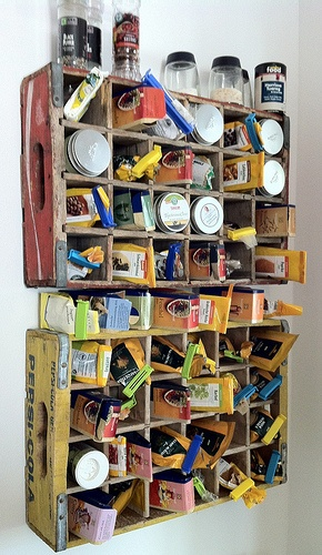 WE HAD A WHOLE COLLECTION OF CAST OFF WOODEN COKE CRATES THAT WE USED TO STORE JEWELRY AND SMALLER TOILETRIES