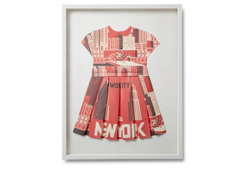 Artist Dawn Wolfe created this original folded-paper collage by carefully assembling hand-cut forms into the shape of a pleated dress. The resulting three-dimensional work is full of charming vintage style. The piece is signed and dated by the artist and set in a classic white shadow-box frame.