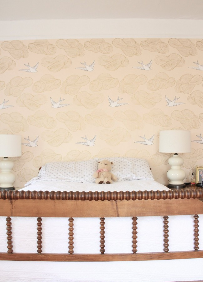 "PHOEBE'S BEDROOM WALL IS WALLPAPERED IN JULIA ROTHMAN ""DAYDREAM"" IN BLUSH FROM HYGEE AND WEST"