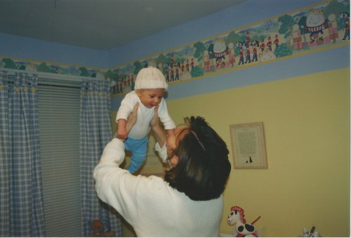 "This is me and tate. In his nursery that I am sure would now be called ""dated and tacky"" but you know what - who cares...I don't. In the end, it all went too fast I would love to have back some of that time to go back and not care so much about how it all looked."