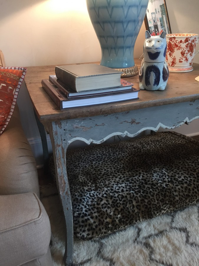 BUNNY WILLIAMS BELIEVES IN MAKING EVERYONE FEEL COMFY - EVEN THE PETS...HENCE THE LEOPARD BED TUCKED UNDER A TABLE - GENIUS!