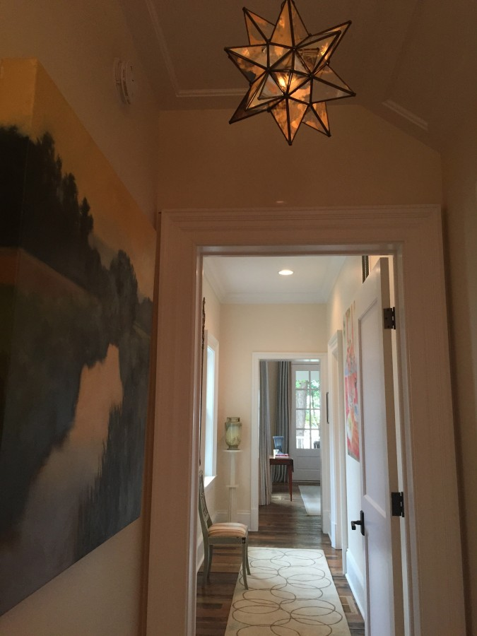 THE HALLWAY TO THE MASTER BEDROOM AND BATH