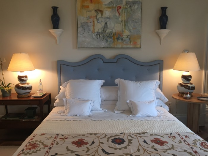 """LIKE MUCH OF THE HOUSE, THE MASTER BEDROOM IS PAINTED SHERWINN WILLIAMS """"STEAMED MILK""""...ALLOWING THE FURNITURE AND ART TO TAKE FOCUS."""