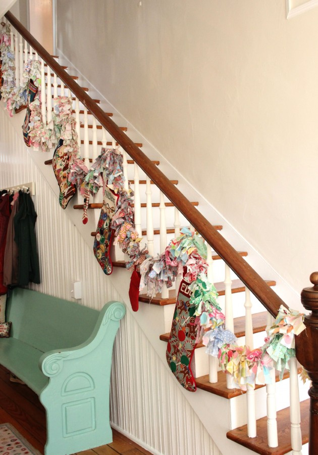 THE STOCKINGS ARE HUNG ON THE STAIRCASE WITH CARE!