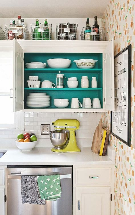 FROM POP SUGAR - ADD A POP OF COLOR INSIDE A CABINET!